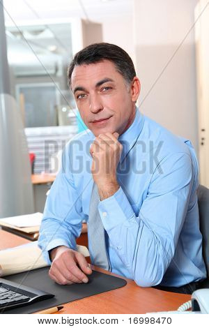 Businessman with blue shirt working in the office