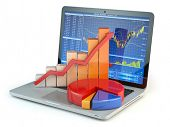 Stock market online business concept. Graph and diagram on laptop keyboard with stock market chart o poster