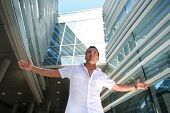 stock photo of modern building  - handsome young guy near modern building - JPG