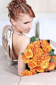stock photo of voluptuous lips  - beautiful young woman with bunch of roses - JPG