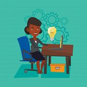 Young businesswoman working on laptop on a new business idea. An african-american happy woman having poster