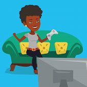 African-american woman playing video game. Excited woman with console in hands playing video game at poster