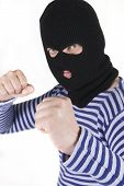 stock photo of shoplifting  - evil male bandit wearing black military mask - JPG