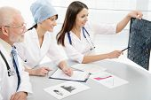 picture of radiogram  - Group of doctors discuss work - JPG