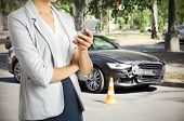 Woman using phone after car accident, closeup. Traffic safety concept. poster
