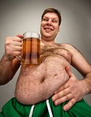 stock photo of beer-belly  - Portrait of funny fat man with glass of beer - JPG