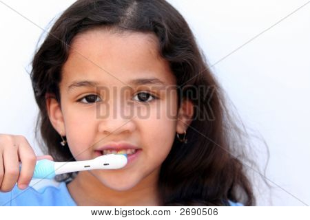 Girl Talking Brushing Teeth