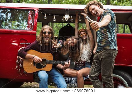 Group of joyous hippies happy