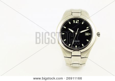 wristwatch on grey