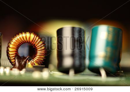 printed circuit board with electronic components, shallow depth of field