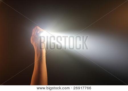 hand holding pocket flashlight