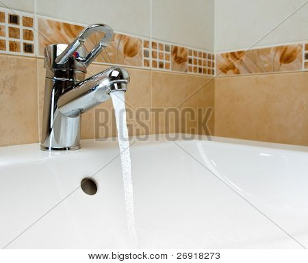 mixer tap with running water