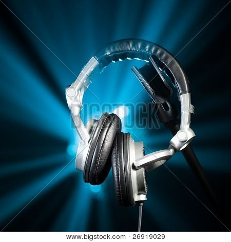 professional headphones against the shiny blue background