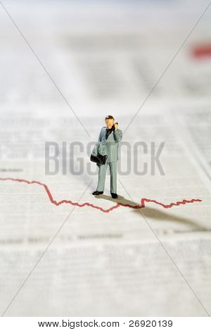 Miniature Model Businessman And Graph
