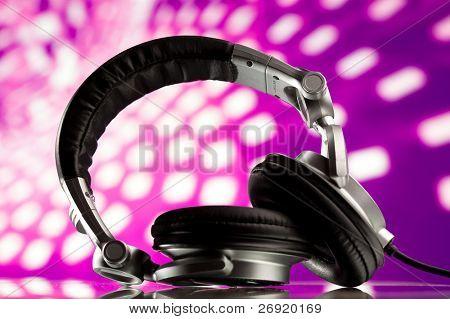 headphones against purple disco background