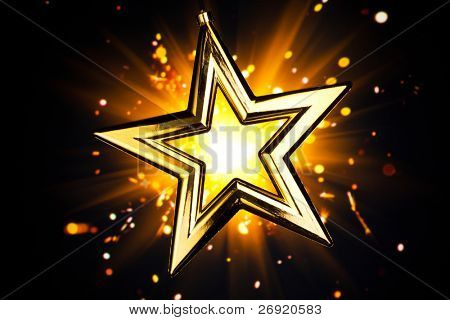 shiny gold star against orange fireworks background