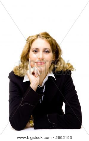 Beautiful Young Businesswoman Sitting At A Table