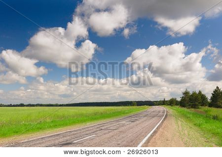 Country road at summer sunny day