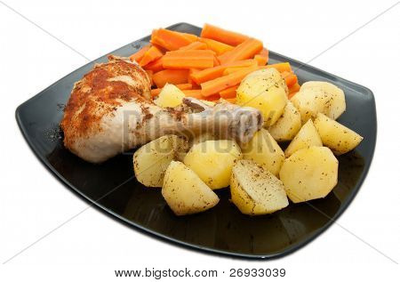 Cooked chicken with carrots and potatoes