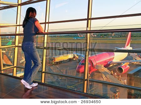 Woman waiting for a plane on airport