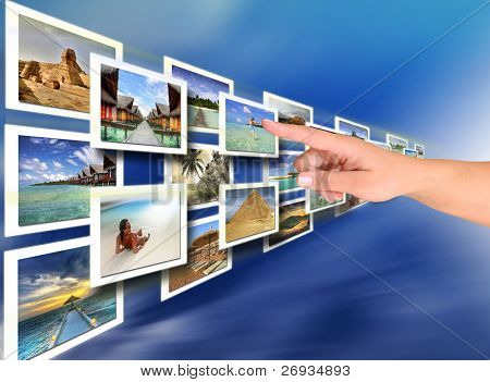 Woman hand choosing a holiday -  all pictures are coming from my gallery