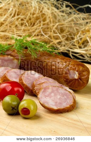 Polish kielbasa with olives and tomatoes