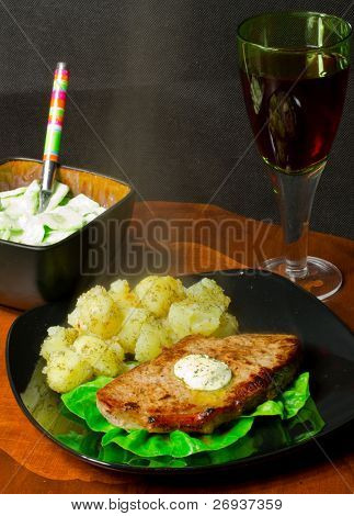 Chargrilled sirloin steak with mashed potatoes, salad and wine