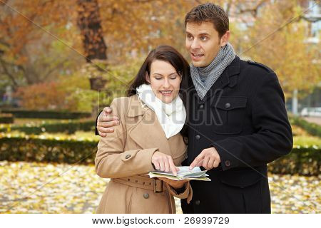 Couple On City Trip Using Map