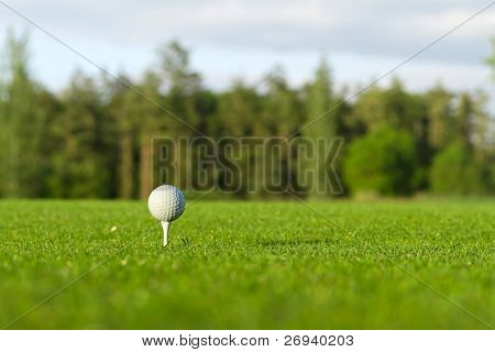Golf ball on the tee - idyllic golf course of Adare