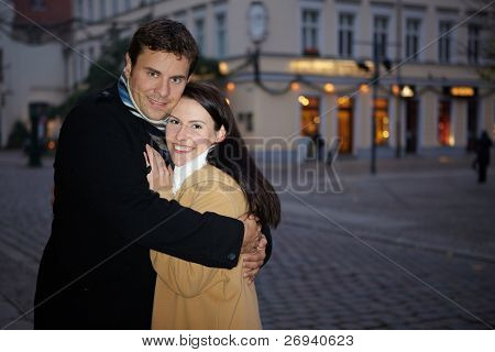 Man Embracing Woman In Winter
