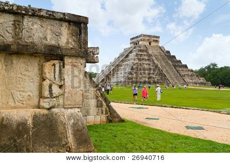 CHICHEN ITZA, MEXICO - JULY 12: Uknown people visiting Kukulkan pyramid in Chichen Itza - one of 7 New World Wonders.  July 12, 2011 in Chichen Itza, Yucatan, Mexico