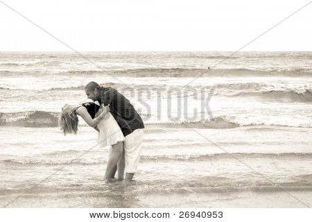 Couple in romantic hug on the beach