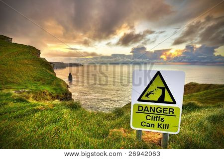 Cliffs can kill sign on Cliffs of Moher, Co. Clare, Ireland