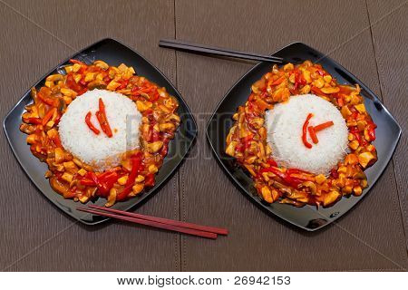 Chinese dish with szechuan chicken and rice