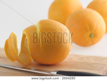 Peeled Orange And Knife
