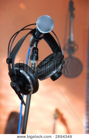 Microphone With Headphones In A Music Recording Studio