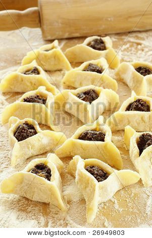Preparing cookies with poppy seed filling  for Purim (Hamantaschen)