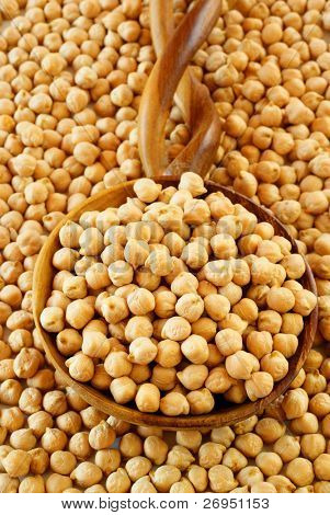 Chickpeas on African wooden spoon