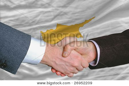 Businessmen Handshake After Good Deal In Front Of Cyprus Flag