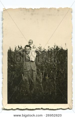 Vintage photo of father and son (forties)
