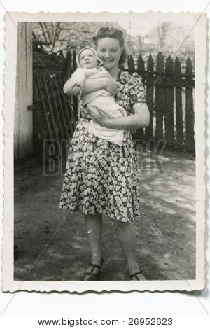 Vintage photo of young mother with her baby (forties)