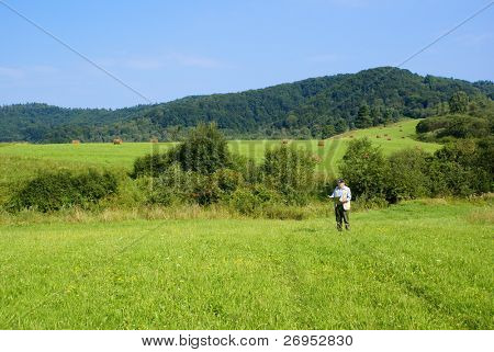 Senior tourist in mountains (Bieszczady, Poland)