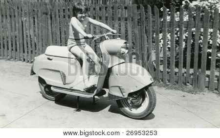 Vintage photo of young girl on scooter (early sixties)