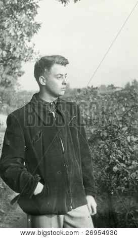 Vintage unretouched photo of young man