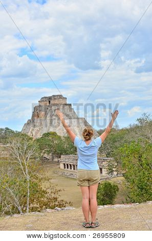 Girl exercising yoga in Uxmal, Mexico - Mayan ruins (Pyramid of Magician)