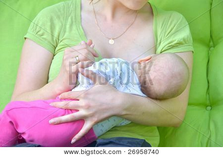 Mother breastfeeding her baby girl