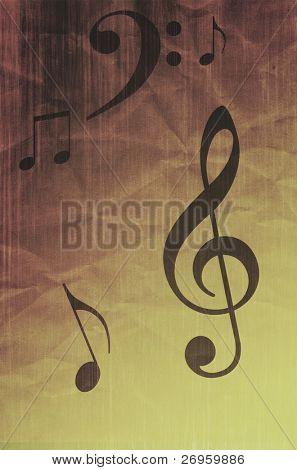 Music symbols on grunge creased paper.