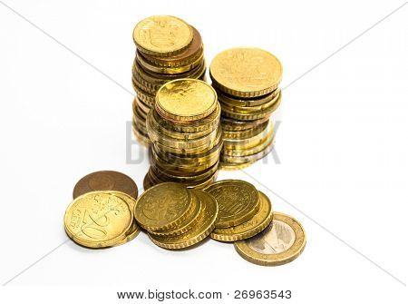 Piles of euro coins isolated on white