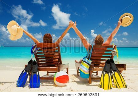 poster of Happy family vacation at Paradise. Couple relax on the white sand of beach. Happy sea lifestyle. You