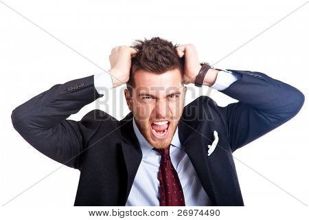 Angry businessman with hands in his hair isolated on white